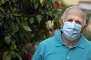 Senior man in mask thinking about COVID and sleep apnea